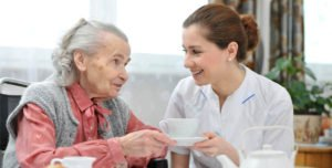 elderly-woman-caregiver-tea