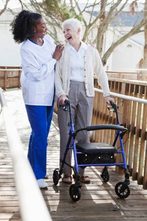 caregiver with elderly woman walking