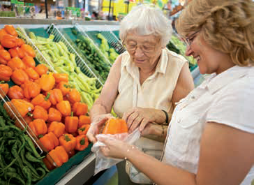 elderly-woman-shopping-caregiver